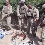 Marine who pissed on dead Taliban wins in court